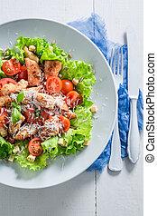 Classic Caesar salad made of fresh ingredients