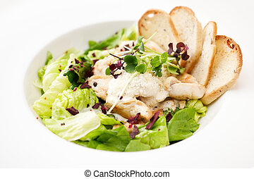 Caesar salad - Classic Caesar salad with chicken on a plate