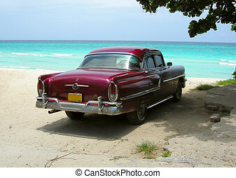 classic car from the sixties on the shores of Varadero beach...