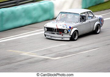 Classic Car Race - Classic car in racing action.