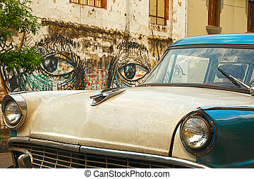 Classic Car with Mural in the Backg