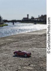 Classic car with Pisa on the background