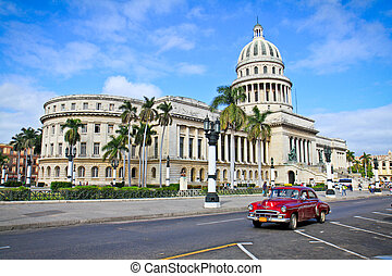 Classic cars in front of the Capitol in Havana. Cuba -...