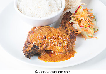 Classic Chicken Rendang with rice and vegetable pickles
