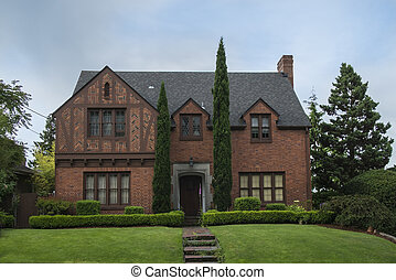 Classic colonial brick house with green lawn