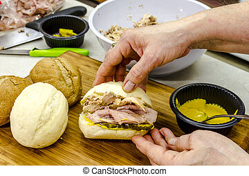 Classic Cuban Medianoche Sandwiches - Female chef hands...