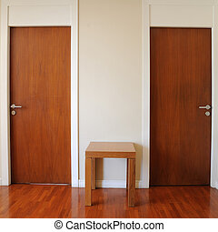 Classic design, double wooden doors with small table