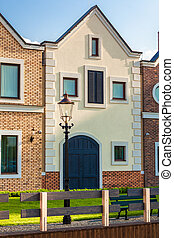 classic dutch houses on street at sunny day - Photo of...
