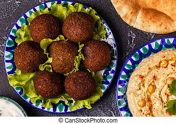 Classic falafel and hummus on the plates.