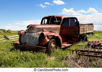 an old chevy farm truck on the outskirts of town, rural wyoming. i believe this to be a chevy '46