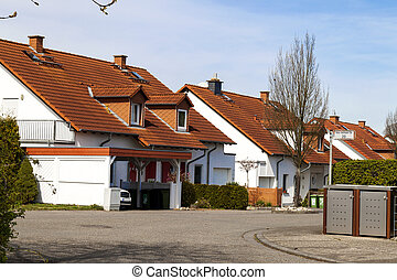 Classic german residential houses with orange roofing tiles and windows