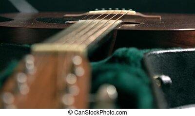 Classic guitar in the case. 4K racking focus shot - Classic...