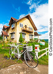 Classic house with pretty lonely bike near the entrance
