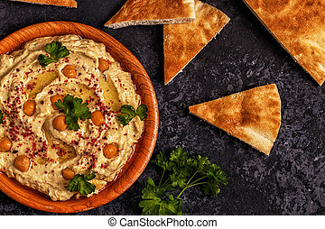 Classic hummus  on the plate.