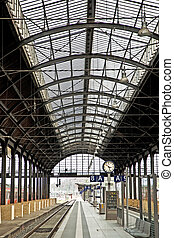 classic iron train station from inside  - train in motion