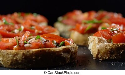 Classic Italian bruschetta, tomato, garlic and parsley on...
