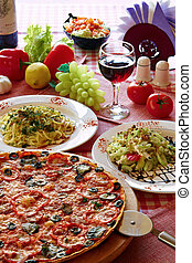 Classic Italian food setting with pizza, pasta, salad and ...