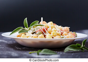 Classic italian lunch with Gnocchi with sage, butter and Parmesan shavings