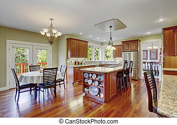 Classic kitchen with hardwood floor, china, and marble counters.