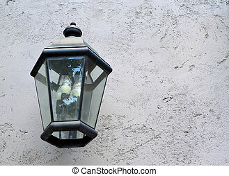 Classic lamp hanging on cement wall