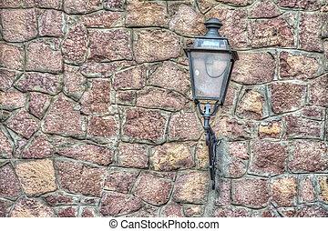 classic lamp in a brick wall