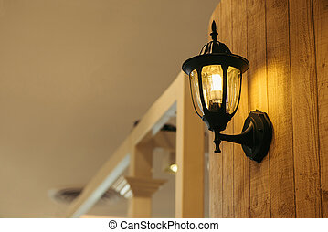 Classic lamp on black wall