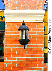 Classic lamp on the brick wall