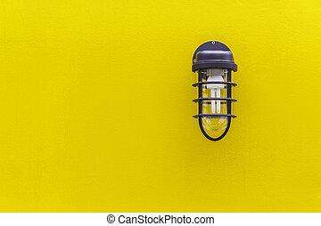 Classic lamp on yellow wall