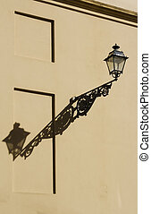Classic lamp with shadow on wall