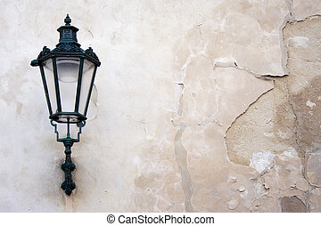 Lantern on a weathered wall.