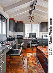 Classic large bright home office interior with modern and antique mixture.