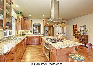 Classic large wood kitchen interior with hardwood floor