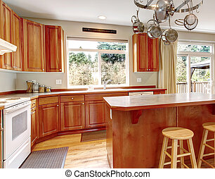 Classic large wood kitchen interior with hardwood floor.