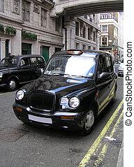 Classic London Cab - Classic London cab on the street.