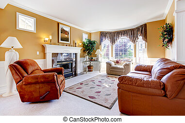 Classic luxury cozy living room interior with fireplace and...