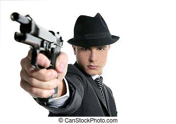 Classic mafia portrait, man with black suit and gun,...