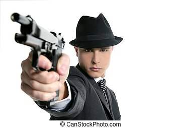 Classic mafia portrait, man with black suit and gun, isolated on white