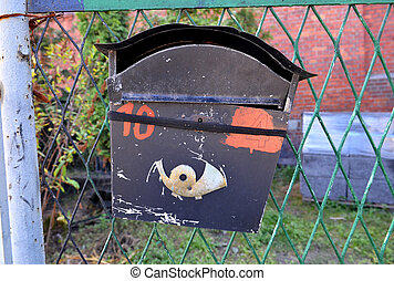 Classic mailbox hanging on the fence. E mail concept