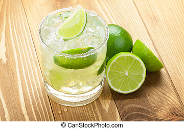 Classic margarita cocktail with lime and salty rim