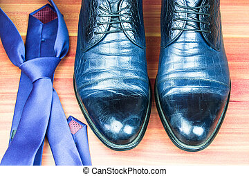 Classic men shoes and blue tie