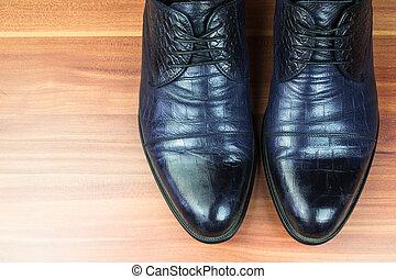 Classic men shoes on wood