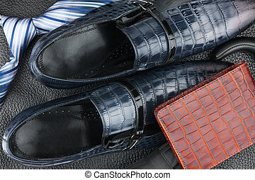 Classic mens blue shoes, tie, umbrella, purse on natural leather
