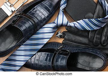 Classic men's shoes, tie, cufflinks, gloves, belt, purse on the