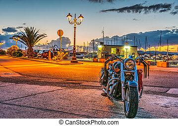 Classic motorcycle in Alghero harbor