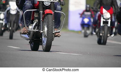 Classic motorcycles. Bottom view of a Bikers riding
