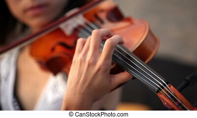 Classic music - Close-up of musician playing violin, classic...