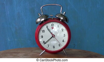 Classic old analogue alarm clock - Classic old analogue red...