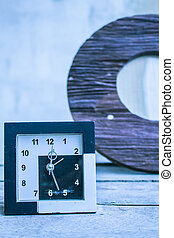 clock on a wooden