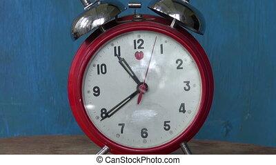 Classic old red alarm clock arrow