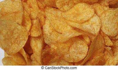 Classic potato chips rotating - Classic golden potato chips...